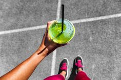 Green smoothie running woman drinking cup to go