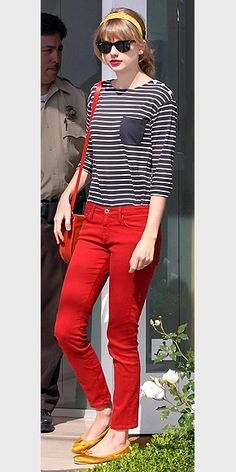 Taylor Swift is always so well put together. Love the gold accessories with the red skinny jeans and blue striped shirt. Goes together so well, kudos to Taylor. (: