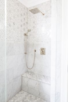 Hex tiles on the floor? Exquisite shower features marble hex tiles on upper walls and stacked marble tiles on lower walls . Marble Tile Bathroom, Bathroom Flooring, Marble Tiles, Hexagon Tiles, Bathroom Canvas, Carrara Marble, Gold Bathroom, Master Shower Tile, Hex Tile