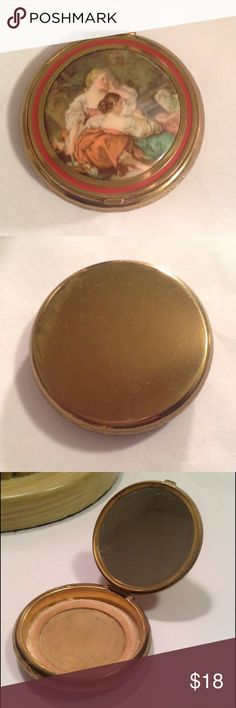 """Vintage Victorian Scene Compact Pretty vintage gold tone compact with a Victorian scene of 2 woman adoring a sheep. Showing some wear but if cleaned up some would be a nice little storage compartment for pills or something. Measures 2 1/4"""" in diameter Vintage Accessories"""