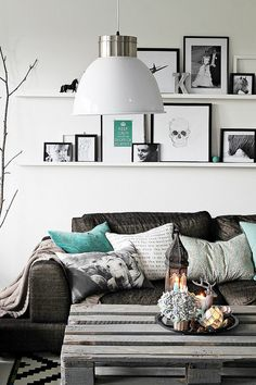 I like the layered frames and floating shelves. For family room??