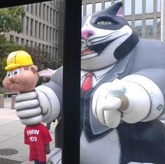 What is a giant inflatable fat cat doing outside the OPM building in DC?