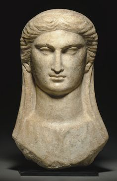 A GREEK MARBLE VEILED BUST OF A WOMAN - CIRCA 2ND-1ST CENTURY B.C.
