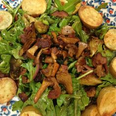 Arugula salad w roasted baby potatoes, roasted brussel sprouts, hericot verts, red onions, chanterelles and bacon bits