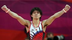 Kohei Uchimura of Japan dismounts the horizontal bar in the Artistic Gymnastics men's Individual All-Around final on Day 5
