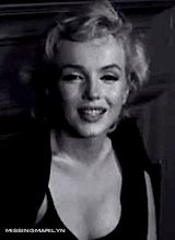 GIF - Marilyn Monroe talks to the press about her recently announced engagement to Arthur Miller, 1956.