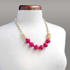 Gen Necklace | $24 | Beautifully rolled pink & ivory paper beads & gold seed beads. Paper beads are handcrafted by women overcoming poverty in Kampala, Uganda. #fairtrade #paperbeadnecklace #shortstrand