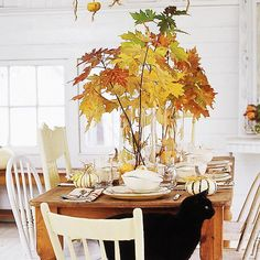 Fall Foliage Centerpiece - Leaves in clear vases....can't get much simpler or beautiful than this))) From Better Homes and Gardens