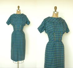 Wonderful classic 1950s plaid wool, double breasted wiggle dress from etsy seller Dalena Vintage. #vintage #1950s #fashion #dresses #secretary_style
