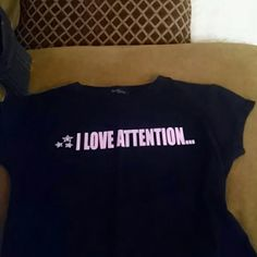 Back short sleeve tee Black tee has lettering that is pink sparkly says I love attention on front and backs says just not from you tag has come off but is a small in good condition just don't wear as it is getting small on me twenty one Tops Tees - Short Sleeve