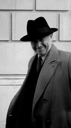 Absolutely love that smile!!!     From kitchenfoyle post dated March 4, 2014:  foyles war ! by Raymond Paul on Flickr.  A big, beautiful grin from Michael Kitchen on the set of Foyle's War near Martins Bank in Liverpool.