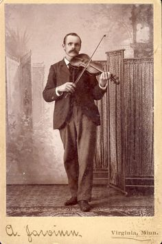 Mustached Man PLAYING STRADIVARIUS VIOLIN Cabinet by NiepceGallery