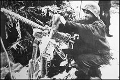 """Browning .30 caliber LMG, in position near Sourbrodt (Belgium), january 1, 1945. You can see him thinking: """"Frozen piece of shit's good for fucking nothing!"""""""