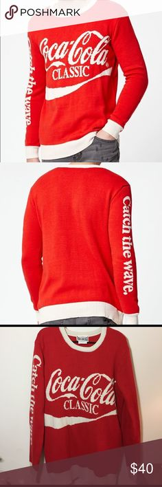 """NWT Coca-Cola Crew Neck Sweater NWOT Coca-Cola Crew Neck Sweater in size large! This throwback-inspired sweater has a classic crew neck, ribbed detailing, a jacquard Coca-Cola logo on the front, and the words """"Catch the wave."""" on the right sleeve. This is a super cute sweater that I purchased from PacSun and never ended up wearing! This sweater is new and in perfect condition  Junk Food Sweaters Crew & Scoop Necks"""