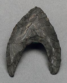 Arrowhead  Period: Neolithic Period Date: ca. 7000–4500 B.C. Geography: From Egypt, Fayum, Petrie excavations, 1926 Medium: Chert Dimensions: H. 4.1 cm (1 5/8 in); w. 2.8 cm (1 1/8 in)
