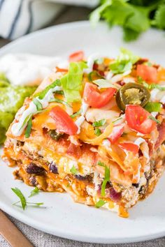 Taco Lasagna is the perfect crowd-pleasing casserole made with tortillas, taco meat, salsa, and cheese! Top it with guacamole and sour cream for a delicious Mexican dinner that everyone will love. Mexican Lasagna With Tortillas, Mexican Lasagna Recipes, Dinner Recipes, Dinner Ideas, Mexican Dishes, Yummy Recipes, Baking Recipes, Taco Lasagna, Baked Lasagna