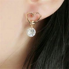 Gold plated heart earrings with clear crystal drop Lovely gold plated heart earrings with clear crystal dropping from the heart. Pierced screwback. 3 available. Jewelry Earrings