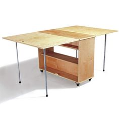 DIY - Folding Workbench - Paint a nice color, design etc... and make into a craft room table with hidden storage.  Fold up and roll out of the way when not in use.
