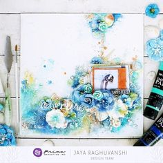 """""""For today's theme I made this beachy mixed-media canvas. Blue is my favorite color when it comes to summertime projects, so I used both Impasto paints in Jade and Cobalt, along with Watercolor Confections in Tropicals to to add color and depth to the canvas. I also made use of lots of Art Stones and shells to give texture to the background. """" ~ Jaya"""