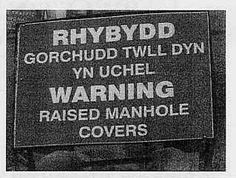 """""""Warning, arsehole cover is high""""  Twll Dyn by Atgof (traed mawr), via Flickr"""