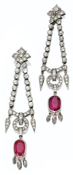 Pair of diamond and ruby pendant earrings, circa 1930. With 7 carats of rubies and 5.75 carats of diamonds.  Via Sotheby's.