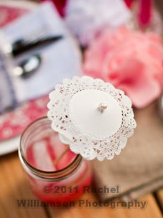 What an adorable party idea! A doily drink umbrella!