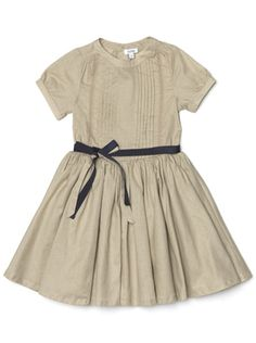 The black sash takes the edge off this otherwise dull colour and the pleat detailing is so pretty!