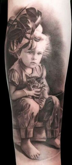 Girl with kitten black and grey tattoo...wow