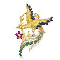 Gold and Gem-set Bird of Paradise Brooch Bird of Paradise brooch set with emeralds, sapphires and rubies in platinum and gold.By Simone Vaillant, American, ca. 1950. #GoldJewelleryBirdOfParadise