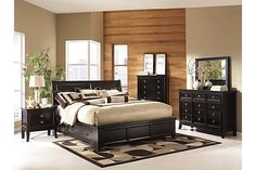 "The Martini Suite Storage Bedroom Set from Ashley Furniture HomeStore (AFHS.com). The ""Martini Suite"" bedroom collection captures the beautiful look of rich contemporary styling with a unique flair that is all its own."