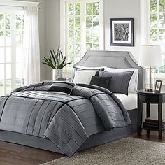 Contemporary, tailored and sophisticated, the Madison Park Bridgeport Comforter Set is soft to the touch with a micro herringbone print and rich tones of grey and black. Black and grey decorative pillows pull it all together.