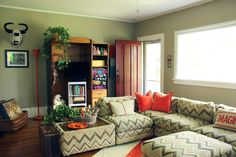 Living room afghan storage | Elise's Eclectic Cottage in the Mountains | ApartmentTherapy