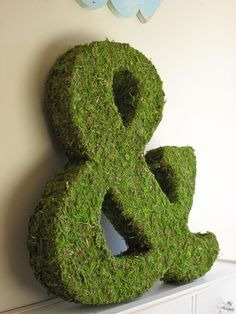 moss-covered ampersand