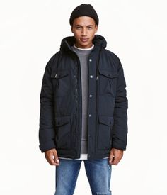 Dark blue. Short, padded parka in woven fabric with a fleece-lined drawstring hood. Zip at front with wind flap and snap fasteners. Chest pockets and front