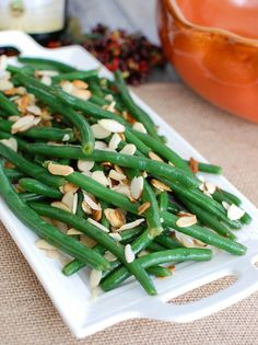 Green Beans with Brown Butter and Toasted Almonds is a nice twist on traditional green beans.  The nutty flavor of the brown butter coats the freshly cooked green beans and is tossed with crunchy toasted almonds.  This is a nice addition to a holiday table. // A Cedar Spoon