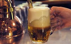 A traditional pouring of Pilsner Urquell beer, Czechia