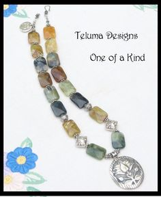 http://www.sellergroup.com/shop/TelumaDesigns  Sterling Silver and Gemstone Necklace with large Sterling Silver Lotus Pendant. Faceted Dust Agate Rectangles. OOAK Handmade Jewellery. (Code 331N)