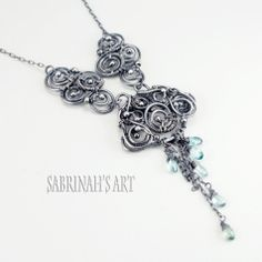 """""""Monsoon"""" Blue Zircon and Sterling Silver Wire Wrapped Necklace"""