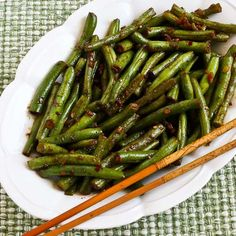 Spicy Sichuan Style Green Beans by Kalyn's Kitchen   1 lb. fresh green beans   2 T soy sauce   1 T rice vinegar (unseasoned)   2 tsp. sugar or Stevia in the Raw   1/4 - 1/2 tsp. red pepper flakes   1/4 tsp. white pepper (or black)   1 T vegetable oil   2 T minced garlic   1 T peeled and minced ginger root