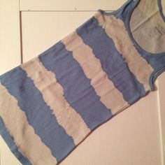 Blue and White Striped Tank Stripes of light blue and off white, looking almost like they're painted on, decorate this adorable tank top. Great for layering or for wearing on its own. Only worn a few times and in good used condition. Old Navy Tops Tank Tops