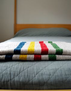 Hudson Bay Inspired Crib Blanket - I'm pretty sure this is knitted but I could crochet something similar. I really want to make g a blanket for his birthday.