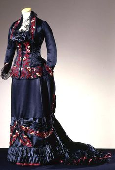 Dress, Atelier Alice Larrot, Paris, ca. 1880. Two pieces, in black satin with embroideries in amaranth silk and chenille thread in floral motifs. Photo: Gabinetto fotografico SBAS, Mario Carrieri. Collection Galleria del Costume di Palazzo Pitti