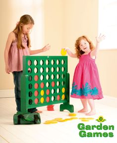 How about a large connect four OUTDOOR game- but instead of pieces, Each space can have a spinning three sided block with a blank side (empty space), a red side and a black side- for when that spot is chosen by a player.  Like the Tic-tac-Toe games at childrens playgrounds
