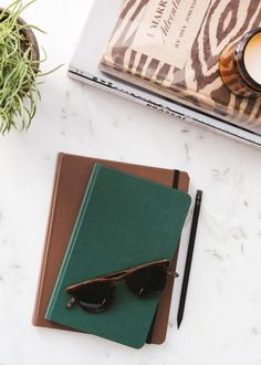 Hard linen journals in forest pine and hickory.