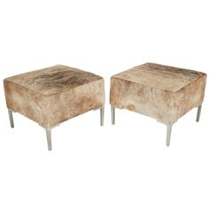 pair of cowhide ottomans