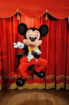 Mickey jumping for joy and can't wait to see you at the Town Square Theater in Magic Kingdom.