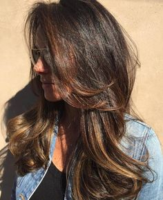 Long Tousled Brunette Balayage Hairstyle