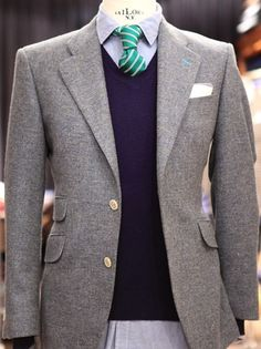 Sweater, tweed, turquoise lapel buttonhole. The buttonhole reminds me of Sherlock's, but spring-ier.