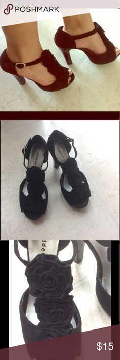 Black roses madden girl heels Suede Madden girl heels size 7 in good conditions. Very comfortable, it is peeling in the inside just in a small spot but unnoticeable when wearing. Madden Girl Shoes Heels