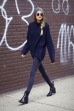 Cute fall outfits that work nearly anywhere, including this skinny jean, oversized sweater, and ankle boots combo